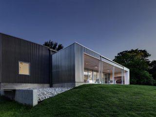 Одноэтажный дом с верандой от Buchanan Architecture